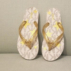 Michael Michael Kors white & gold flip flops